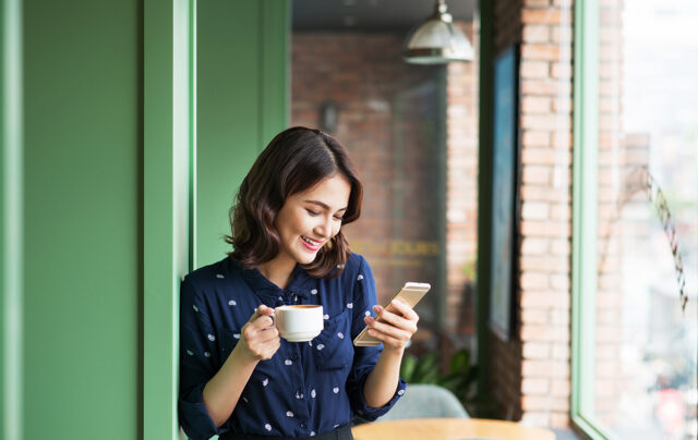 woman checking her phone and feels her information is secure