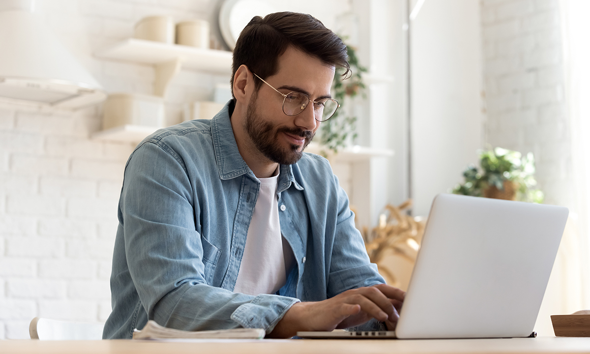 Man using a laptop, checking his personal data.